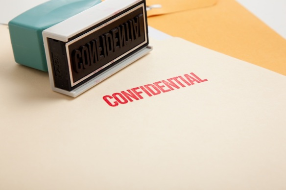 Folder stamped with confidential red confidential stamp paperwork documents 101052866